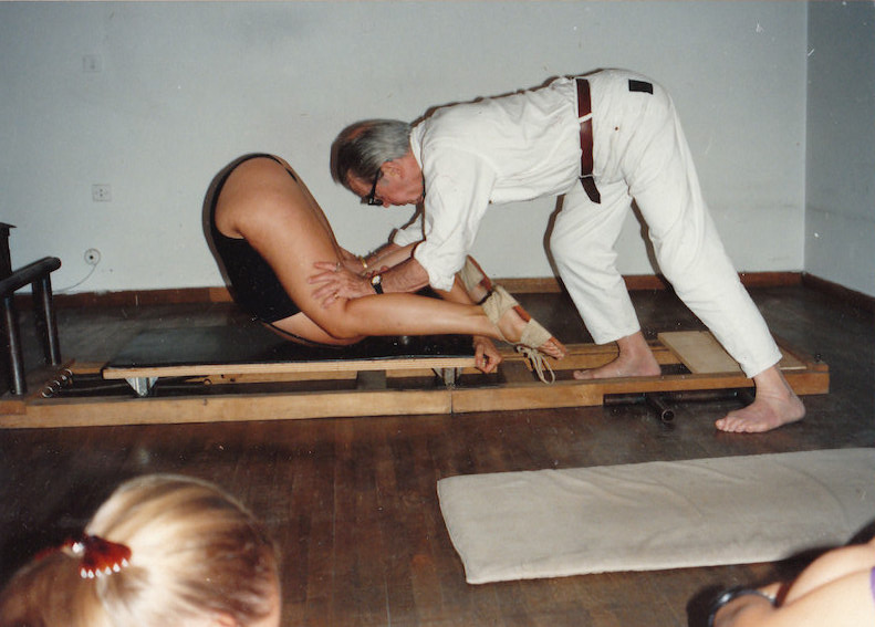 Jerome assisting a student in the Spine Roll